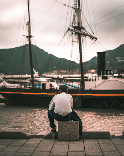 Rear view of man on sailboat