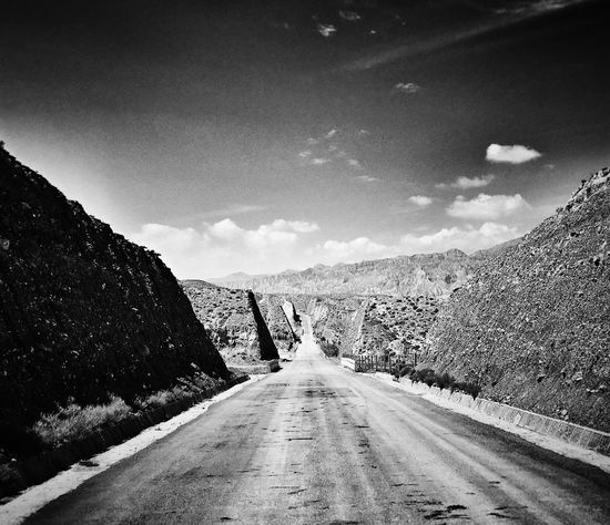 The Way Forward Transportation Road Sky Cloud Tranquil Scene Landscape Mountain Diminishing Perspective Country Road Non-urban Scene Tranquility Solitude Long Vanishing Point Outdoors Remote Countryside Day Mountain Range