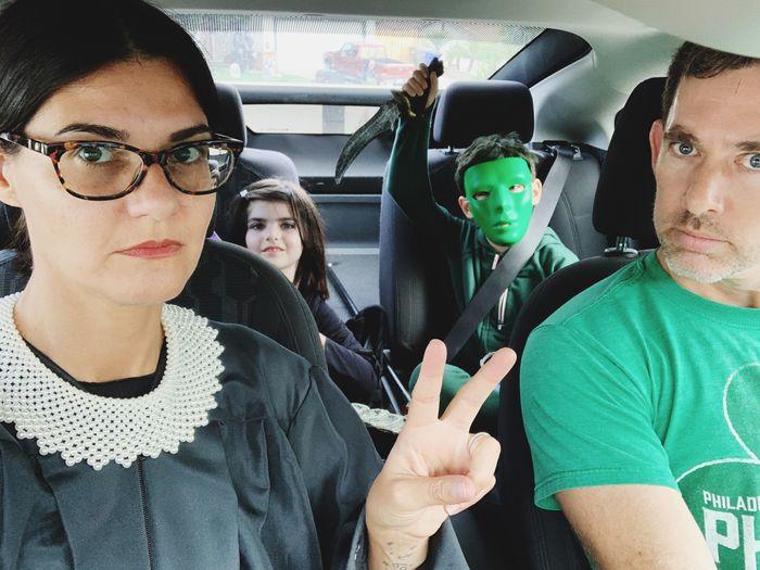 Portrait of friends sitting in car
