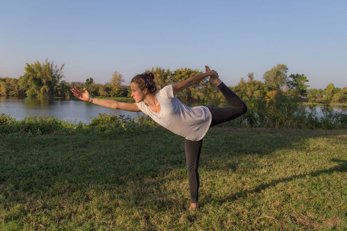 Balance Beauty Beauty In Nature Day Friendship Grass Nature Nature Reserve One Person One Woman Only One Young Woman Only Only Women Outdoors People River River View Riverbank Riverside Sport Yoga Yoga Pose Yoga ॐ Yogaeverydamnday Yogagirl Young Adult