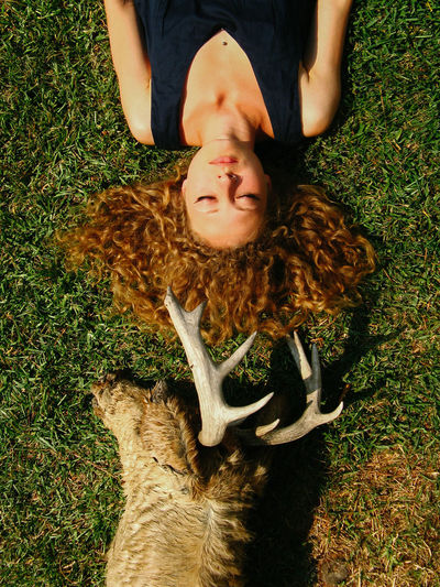 Lying Down High Angle View Lying On Back Grass Nature Hairstyle Young Adult Casual Clothing Real People Dead Animal Taxidermy Deer Animal Head  Death Dead Portrait Portrait Of A Woman Girls Young Women Curly Hair Beautiful Woman Weird Dark Gloomy Sinister