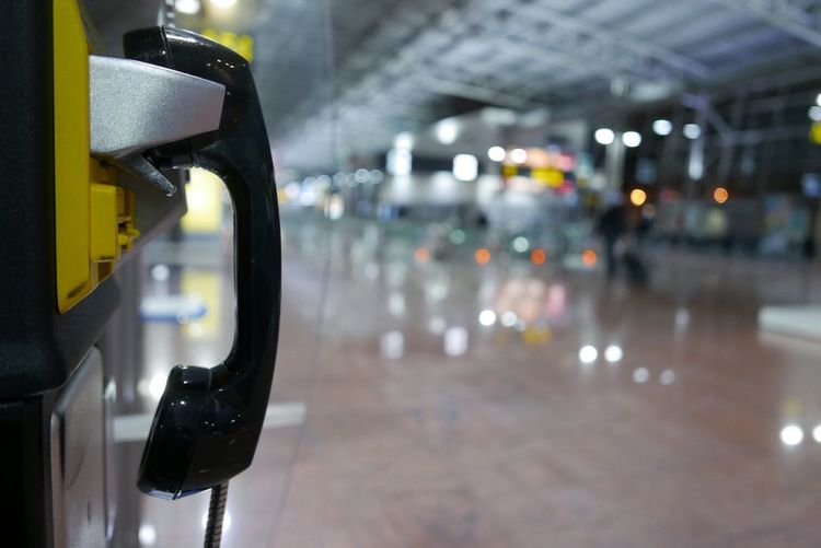 Close-up of pay phone at airport