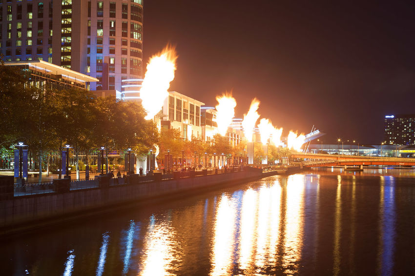 Melbourne CBD - APR 16 2016: Crown Casino famous fire show - powerful bright flames emitting from industrial structures reflection in Yarra river Australia Australian Australian Landscape Beautiful Crown Casino Melbourne City Travel Architecture Australian Photographers Building Exterior Built Structure Celebration City Cityscape Clear Sky Fire Show Firework - Man Made Object Firework Display Flame Illuminated Landscape Long Exposure Melbourne Night No People Outdoors Reflection Sky Travel Destinations Travel Locations Tree Water Waterfront