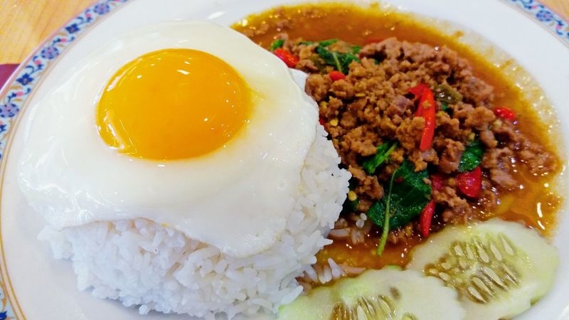 Basil fried rice with minced meat and fried egg on top Egg Food Rice Food And Drink Ready-to-eat Indoors  Close-up Fried Egg Egg Yolk No People Plate Healthy Eating Meat Freshness Day Lunch Breakfast Basil Thai Food Spicy Food Minced Meat Minced Pork Basil Fried Chicken And Fried Egg EyeEmNewHere