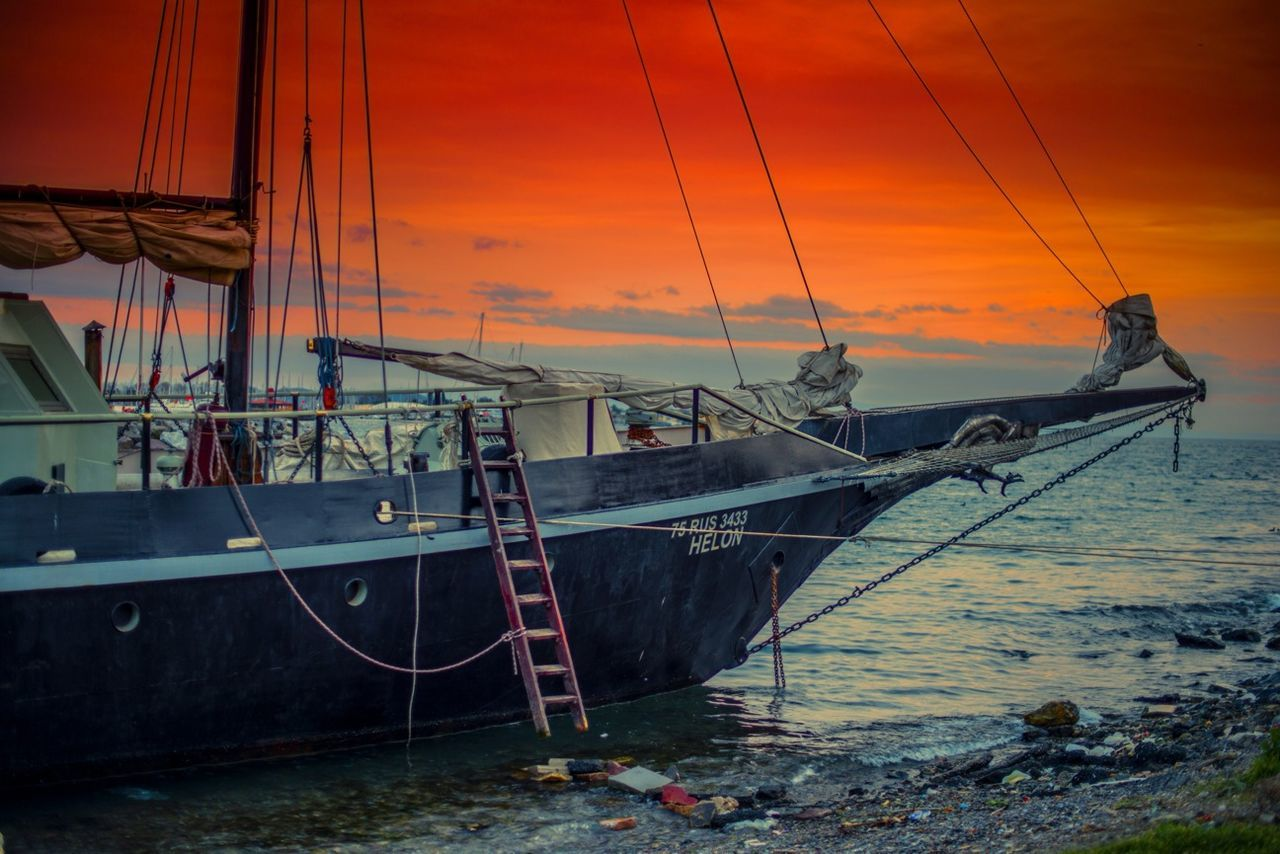 nautical vessel, transportation, mode of transport, sunset, sea, boat, water, moored, orange color, sky, rope, nature, no people, mast, outdoors, longtail boat, beauty in nature, scenics, horizon over water, outrigger, sailing ship, tall ship, day
