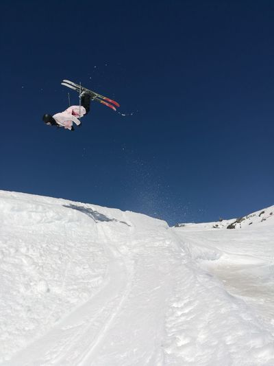 Low angle view of a backflip on skis