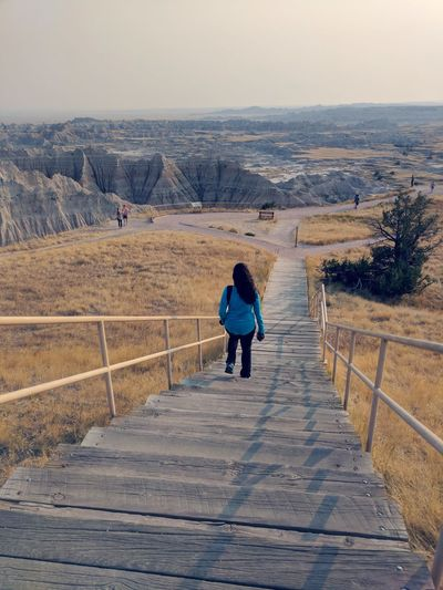 Stairs The Way Forward Badlands South Dakota Full Length Women Rear View Adventure Sky Landscape Arid Climate Arid Landscape Atmospheric Extreme Terrain Rugged Physical Geography Hiker