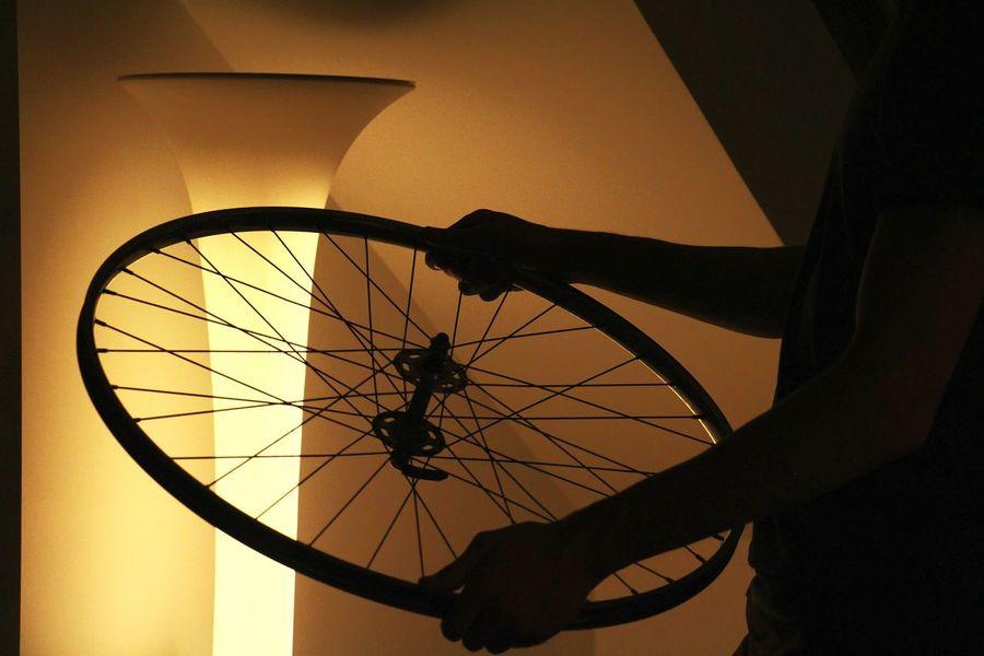 Fixing my bike in the dark. Light And Shadow Silhouette EyeEm Best Shots Nightphotography Light Minimalism Light In The Darkness Monochrome Taking Pictures Orange By Motorola Market Bestsellers 2017