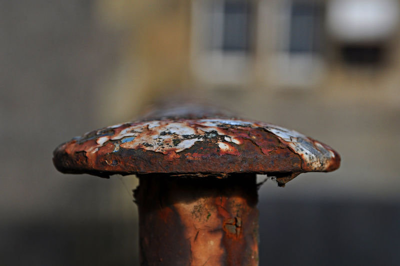Close-Up Of Rusty Metallic Bollard