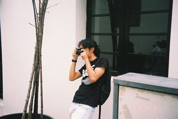 Young man photographing