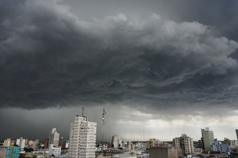 Tormenta sobre la ciudad de Río Cuarto, Córdoba, Argentina. Storm Stormy Weather Architecture Building Exterior Built Structure City Cityscape Cloud - Sky Clouds Clouds And Sky Day Modern Nature No People Outdoors Sky Skyscraper Storm Cloud Storm Clouds Tower Travel Destinations Urban Skyline