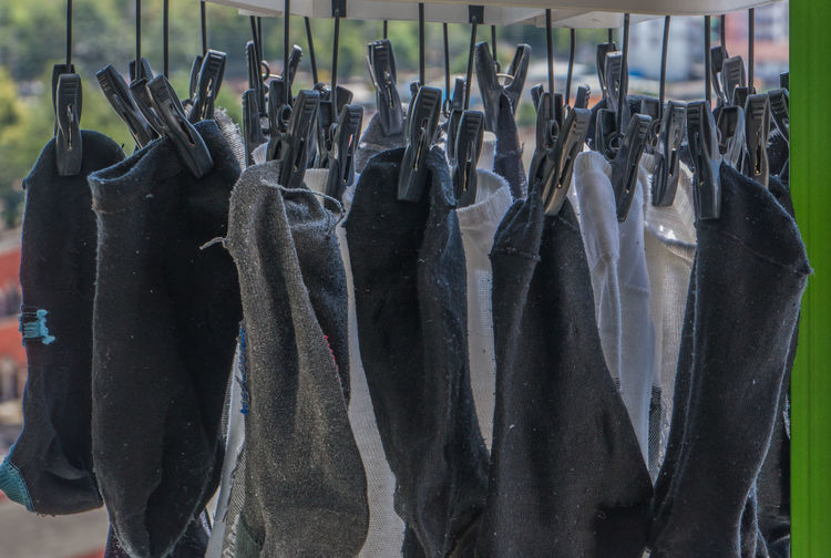 Close-up of clothes hanging in rack at store