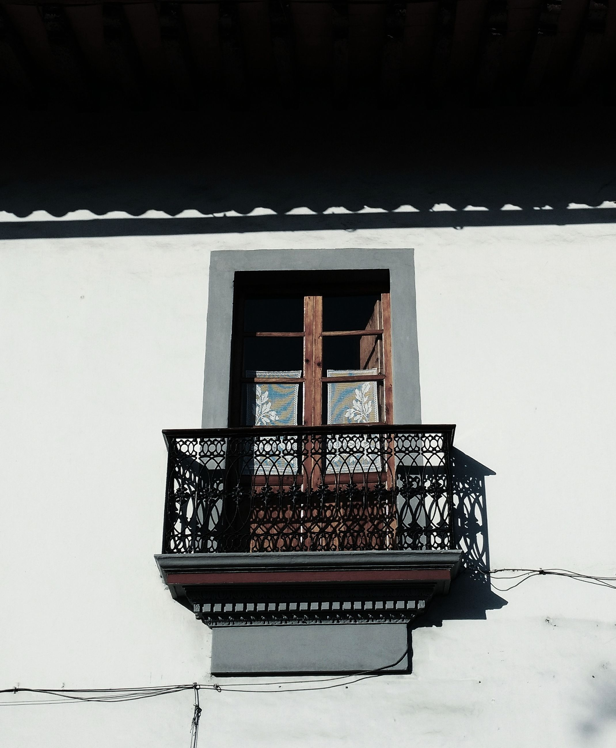 window, built structure, architecture, building exterior, day, outdoors, geometric shape, no people, wrought iron