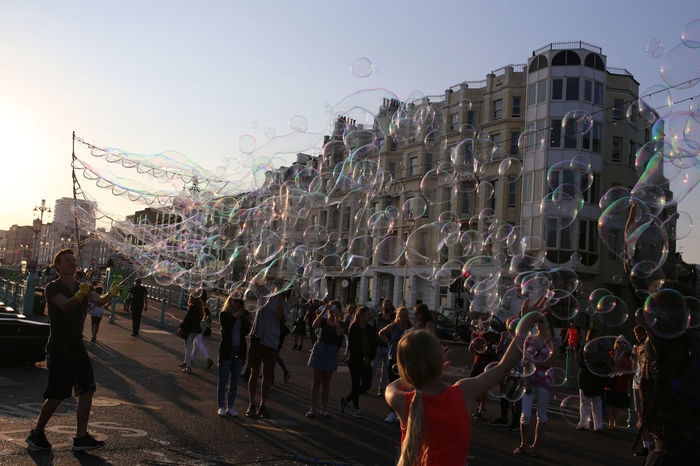 Brighton Bubble Man Bubble Time Bubbles Crowds Crowds Having Fun Entertaining Entertainment Fun Fun In Brighton Happy Happy Kids Holiday Time Kids Loving The Bubbles Man Blowing Bubbles Man Making Giant Bubbles People Reaching Up Smiling Street Entertainer Streets Summer Things To See Tourists Visitors