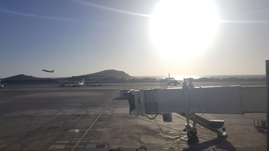 Airplanes on airport against clear sky