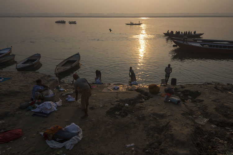 People washing clothes on the ghats of Varanasi Banaras Boats Clothes Dhobi Ganga Ganges Kasi Large Group Of People People Reflection River Street Sunrise Varanasi Washing Water