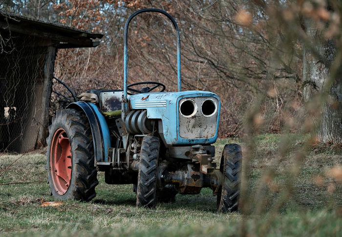Abandoned Agriculture Day Field Land Vehicle Mode Of Transport Nature No People Old Tractor Outdoors Round Shape Rural Environment Stationary Tractor Tree Vintage