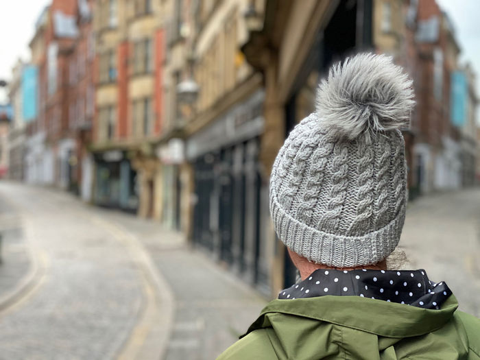 Rear view of woman in winter
