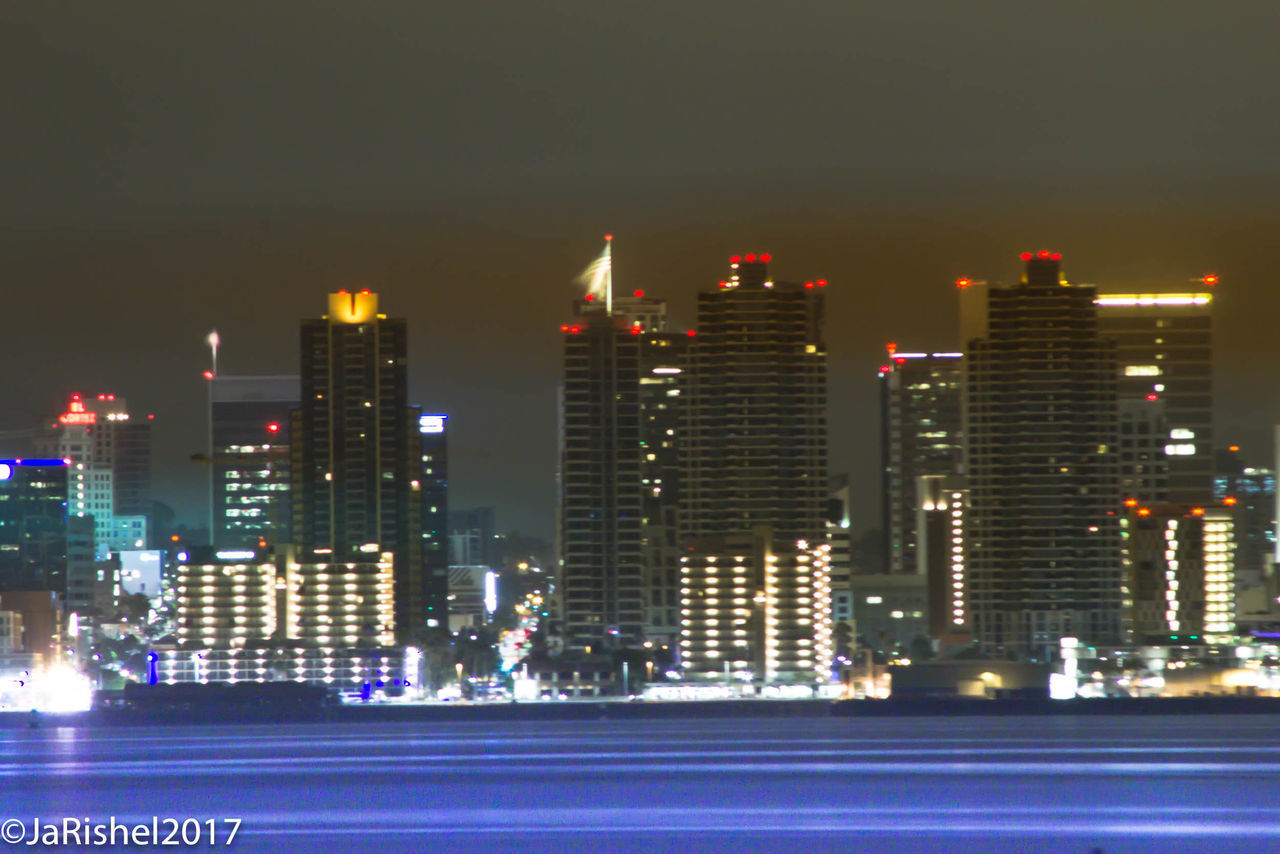 illuminated, city, architecture, skyscraper, building exterior, cityscape, built structure, night, modern, downtown district, urban skyline, no people, travel destinations, outdoors, water, growth, sky