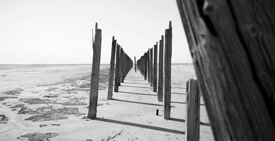 Abandoned pier Beach Black & White Black And White Clear Sky Day Desolate Dried Horizon Over Water Nature No People Outdoors Pier Salt Lake Sand Sea Sky Water Wood - Material