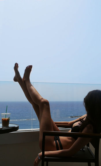 Cyprus View Adult Balcony Bodyart Clear Sky Copy Space Day Horizon Horizon Over Water Leisure Activity Lifestyles Nature Outdoors People Real People Relaxation Sea Sky Summer Swimming Pool Water Women Young Adult Young Women