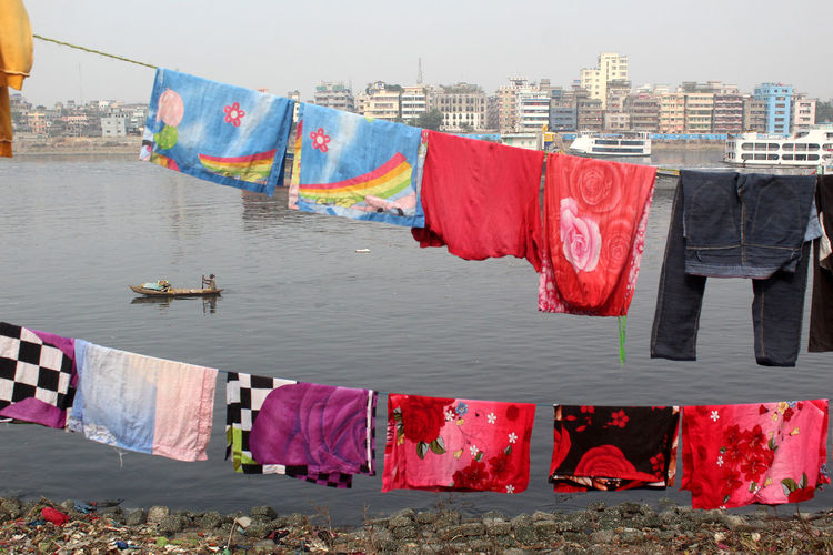 Building Exterior Drying Architecture Hanging Built Structure City Clothing Laundry Water Clothesline Textile Nature Outdoors No People Multi Colored Building Housework Washing Boat River Urban
