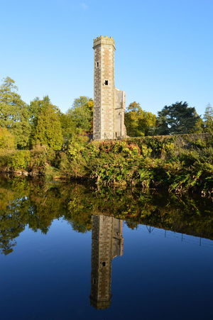 Reflection Water Built Structure Clear Sky Tree History Architecture Sky Building Exterior Nature Outdoors Travel Destinations Scenics Day Reflection Lake Ruins Architecture Ruins Ruins Of A Castle Bricks And Stones Beauty In Nature Beauty In Everything Sunny Days Brightness