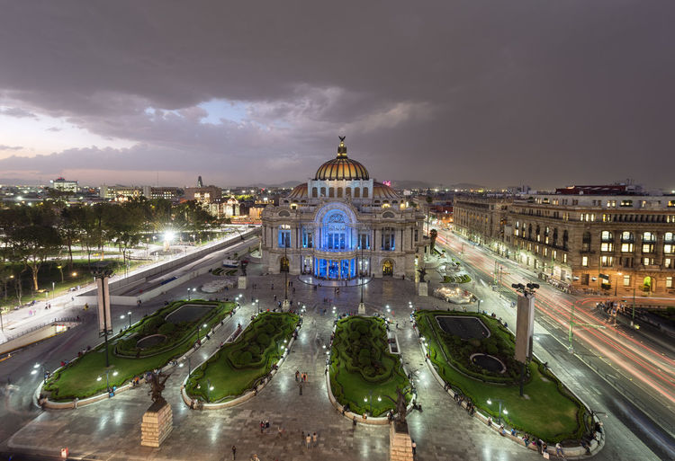 High angle view of illuminated palacio de bellas artes against cloudy sky during sunset