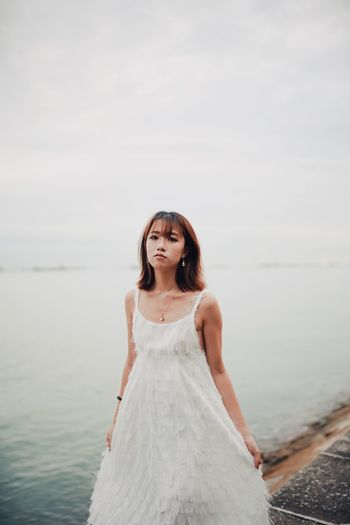 Crystal Stay Out Exploring Fun My Best Photo Singapore One Person Water Young Adult Looking At Camera Portrait Front View Beautiful Woman Women Sea Beauty Sky Adult Fashion Dress Lifestyles Young Women Standing Leisure Activity Hairstyle Outdoors Contemplation
