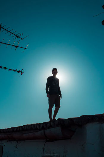 Blue Casual Clothing Clear Sky Day Full Length Hicontrast Leisure Activity Lifestyles Low Angle View Nature Outdoors Sky Sunlight Sunny