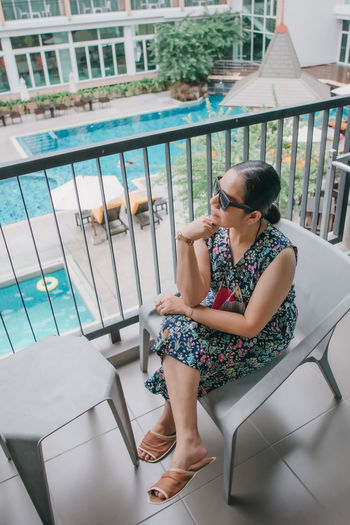 High angle view of woman sitting in swimming pool
