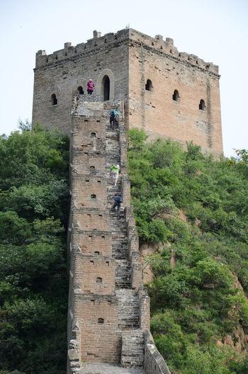 People walking on great wall of china at jinshanling
