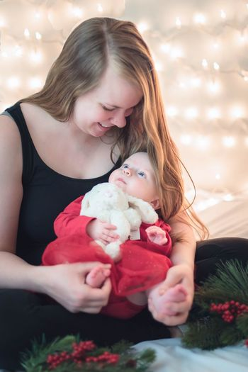 Mommy and her newborn at Christmas. Bokeh Lights Unconditional Love Mommy Mommy & Baby Time <3 Christmastime Christmas Lights Newborn Bokeh Photography Christmas Lights EyeEm Selects Women Females Child Childhood Positive Emotion Love Emotion Family Mother Holding Young Baby Parent Togetherness Offspring Teddy Bear Toy