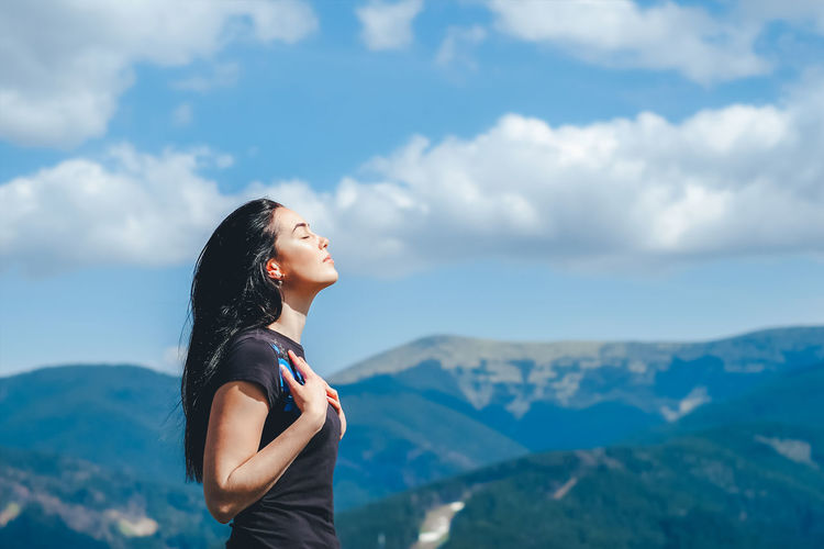 One Person Cloud - Sky Sky Young Adult Mountain Leisure Activity Standing Lifestyles Side View Beauty In Nature Young Women Adult Real People Mountain Range Scenics - Nature Women Nature Tranquility Hair Hairstyle Beautiful Woman Outdoors Contemplation