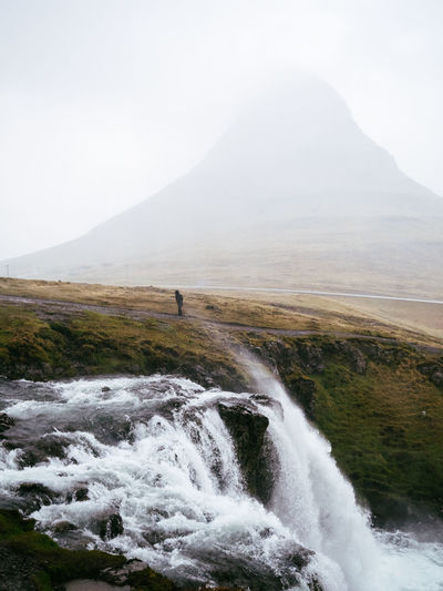 Adult Beauty In Nature Cold Temperature Day Fog Iceland Kirkjufell Kirkjufellsfoss Landscape Mountain Nature One Man Only One Person Only Men Outdoors People Rough Scenics Sky Storm Water Waterfall Wave Weather Wind