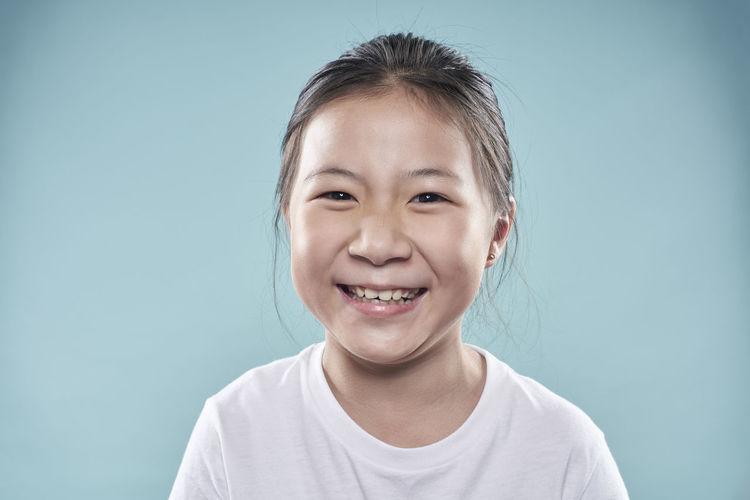 Portrait of smiling boy against blue background