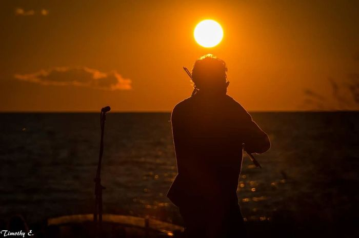 Sun sets as the fiddle plays. Sunset Silhouette Outdoors People Music Music On The Beach Nikon D7000 Canada Coast To Coast Ontario, Canada NikonLife Grand Bend, Ontario The Week On EyeEm