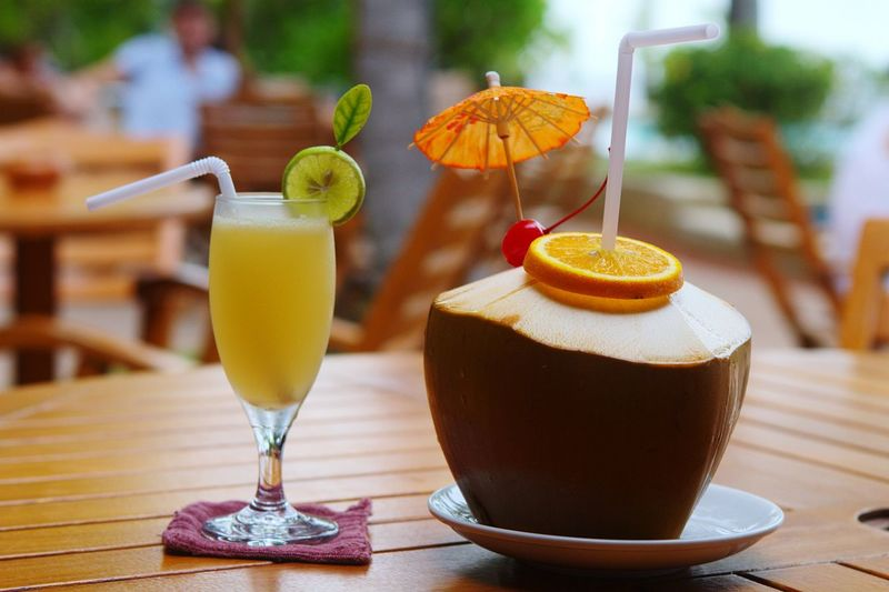 Drink and coconut served on table