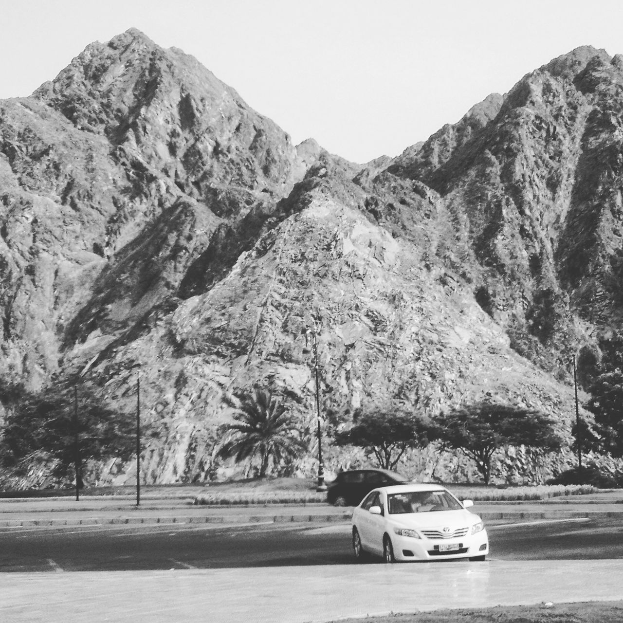 mountain, car, tree, transportation, mountain range, road, nature, no people, land vehicle, outdoors, beauty in nature, day, scenics, clear sky, sky