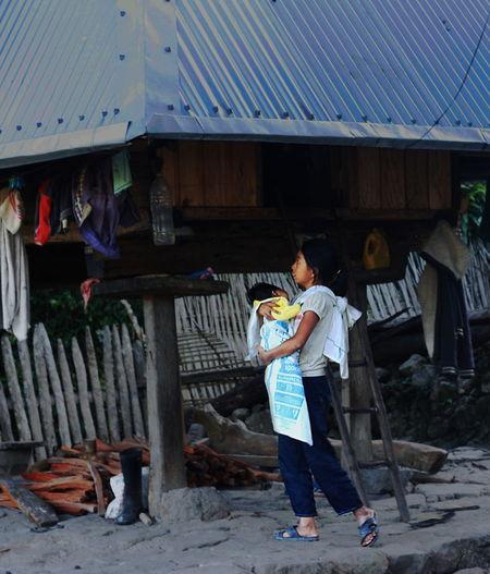 Full length of man standing outside house in village