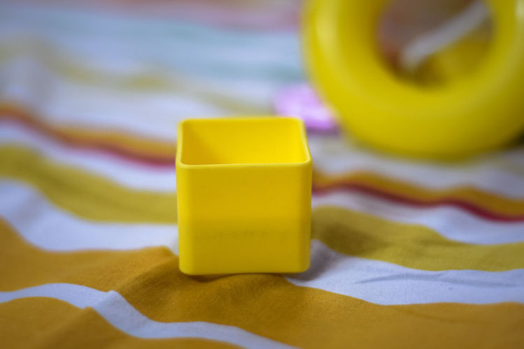 Close-Up Of Yellow Plastic Toy