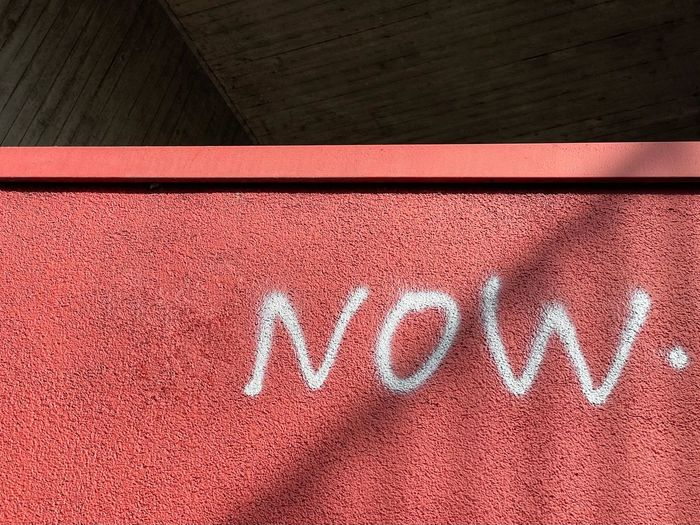 High angle view of text on red wall