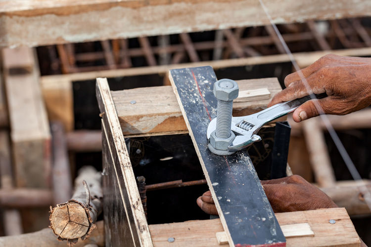 Cropped Hand Of Carpenter Working On Wood