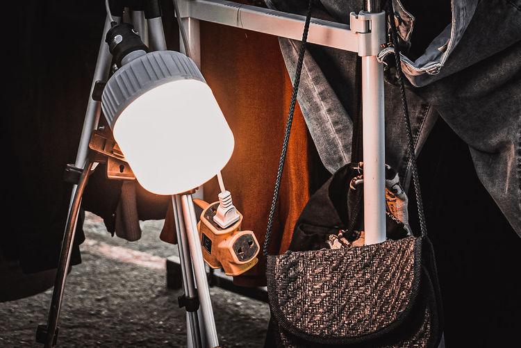 Close-up of lighting equipment hanging at market