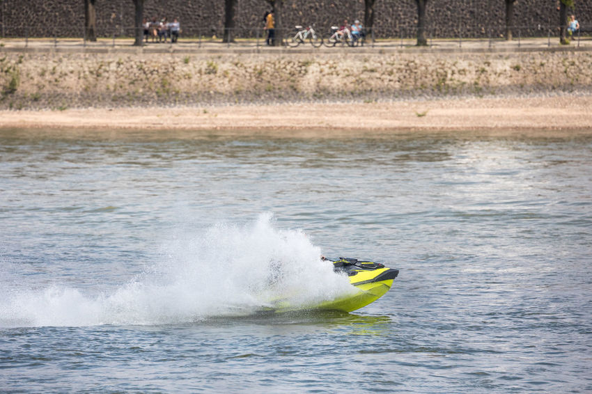Promenade Relaxing Rhein Wave Adventure Beauty In Nature Day Incidental People Jetski Leisure Activity Lifestyles Men Motion Nature Outdoors People People In The Background Power Power In Nature River Sea Splashing Sport Unrecognizable Person Water Waterfront