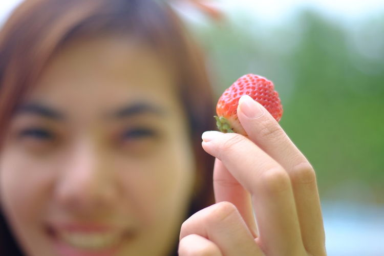 Hand holding freshy mini strawberry Smiling Blurred Background Holding Holding Hands Human Hand Eating Women Young Women Mid Adult Fruit Close-up Strawberry Berry Fruit Salad Fingernail