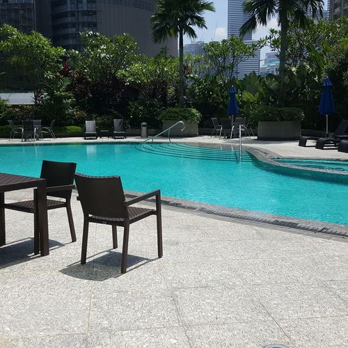 Swimming Pool Water Chair Tree Day Luxury Furniture No People Outdoors Nature Eye4photography  EyeEm Nature Lover Swimmingpool Beauty In Nature The Week On EyeEm From My Point Of View City Coolin It Swimming Time Kuala Lumpur Malaysia