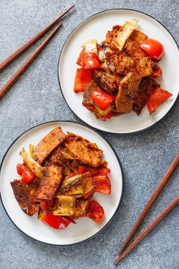 Szechuan Dish ASIA Asian  Food Pork Fried Cooked Two Dinner Persons Sticks Vegetables Spicy Chili. Hot Recipe Portion Top Above View Plate Bowl Pieces Soy Sauce Fry Wok Chinese Roasted Pan Meat Pepper Bell Leek Onion Food And Drink Ready-to-eat Freshness Chicken Chicken Meat Indoors  High Angle View Table Directly Above No People Still Life Vegetable Meal Healthy Eating Barbecue White Meat Marinated Tray Fried Chicken