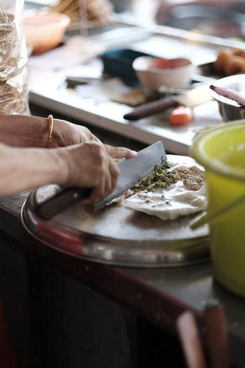 Cropped image of women preparing food at stall
