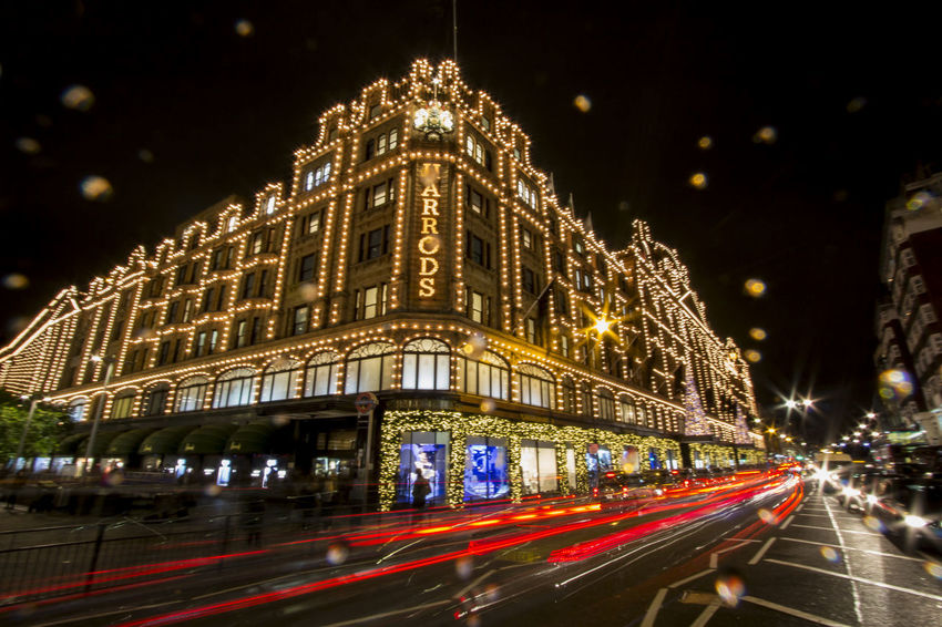 "Xmas Fever Again This is the iconic shopping place in London - the Harrods. One of the world's most famous department store online with the latest of the latest on the table. Their motto is ""Omnia Omnibus Ubique"", which is Latin for ""all things for all people, everywhere"". It is owned by the state of Qatar. Xmas, that brings the life back to the streets, brought a brilliant face lift to Harrods. I was standing in the middle of road crossing, taking this photo. Was later approached by traffic security to move on :) Architecture Celebration Christmas Christmas Decoration City Cityscape EyeEm EyeEm Best Edits EyeEm Best Shots EyeEm Gallery EyeEm Masterclass EyeEmBestPics Eyeemphotography F/∞ Harrods Illuminated London London Lifestyle London_only Motion Night Shuttercrazy Sohillaad SohilLaadPhotography Traffic"